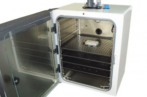 Inside incubator with one plate holder on top shelf
